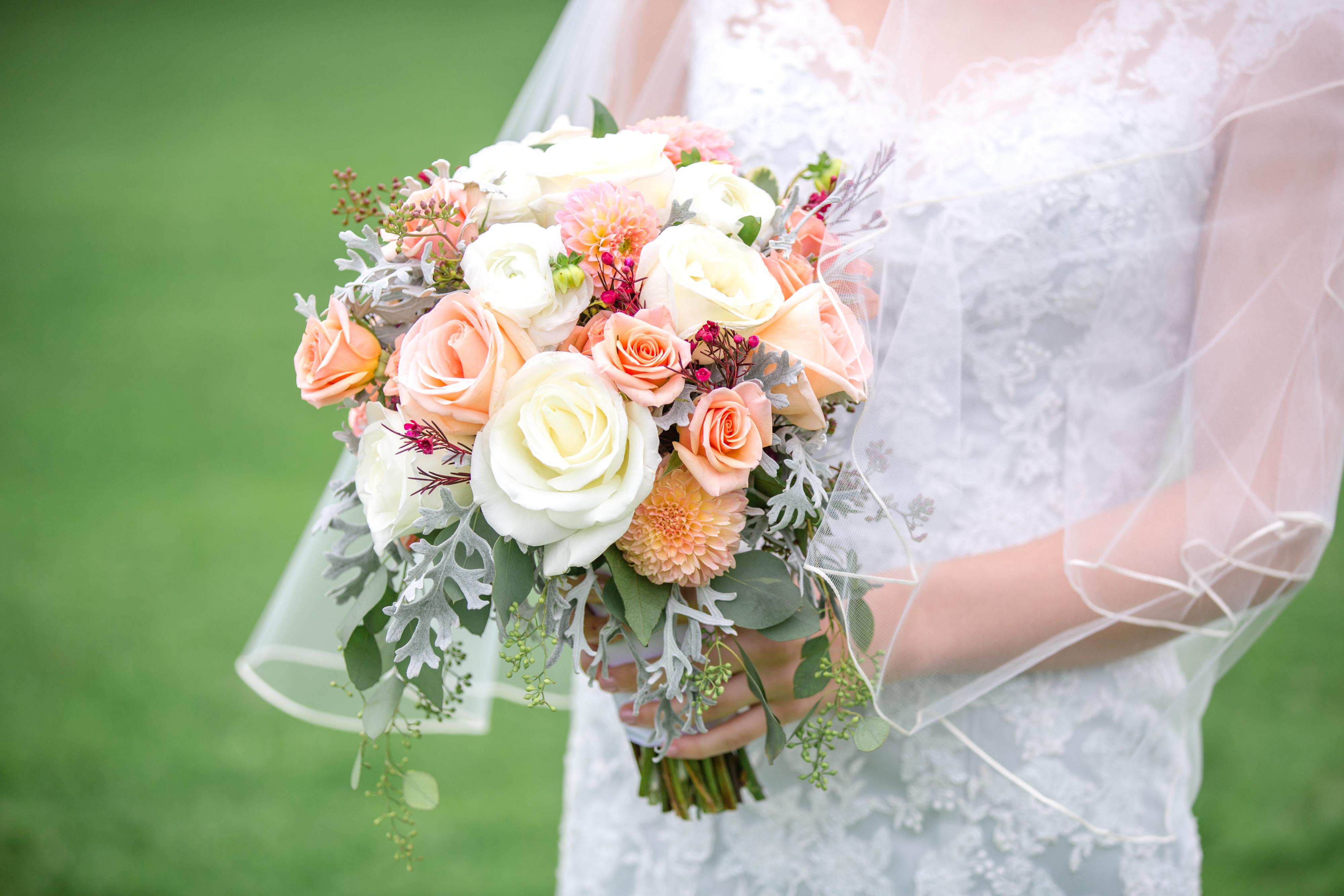 Emilee Janitz holds her wedding bouquet.